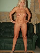 Blonde mature plumper Remy posing in her lingerie and bares it all to show off her plump sagged tits