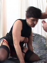 Lingerie clad grandma Jozsefne moans loudly as she rams her pussy with a hard cock live