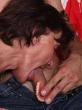 Granny Stephanie sits on top of a younger guys lap and rides his cock during a webcam show