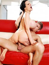 Horny mature cam model Sofia Stacks shows her huge rack while riding a cock on the couch