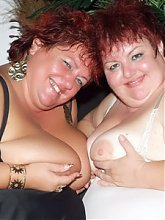 Louise and Mindy are chunky older gals showing off their breasts and sharing a cock